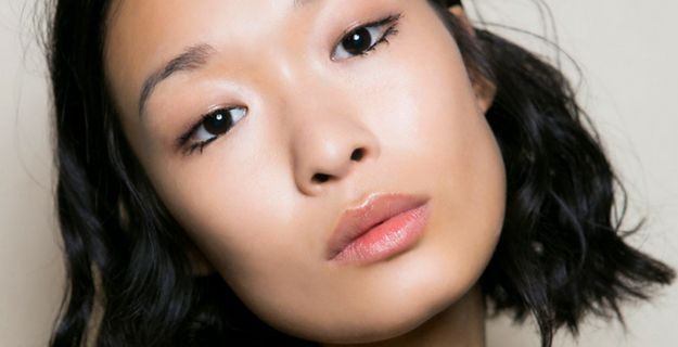 profile of asian woman with glowing skin